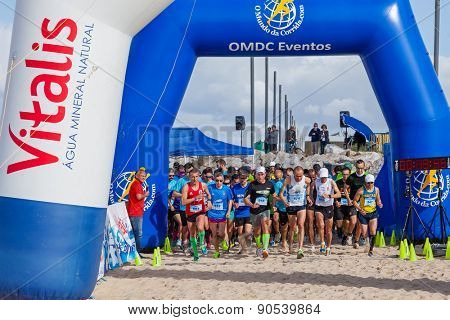 Costa da Caparica, Portugal. April 19, 2015: Meia Maratona das Areias - Half Marathon of the Sands - start line. Running competitions on the sand are an athletic event growing in popularity