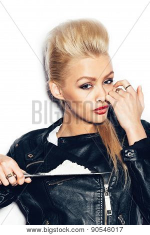 Swag girl in black leather jacket sniffing cocaine (imitation flour). Sexy blonde Woman stoned. White background not isolated poster