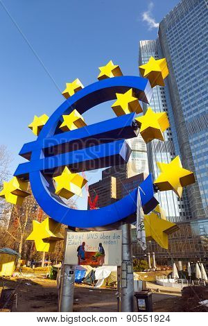 Euro Symbol In Front Of The European Central Bank With Occupy Camp  In Frankfurt