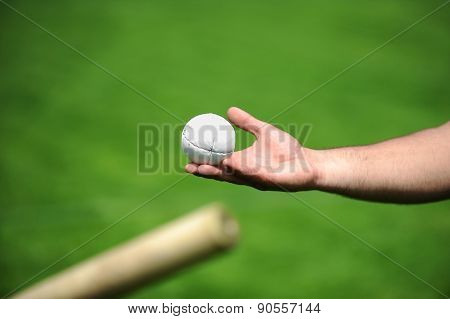 Hand Holding A Rounders Ball