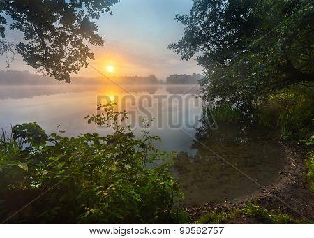 Beautiful sunrise over misty lake. Foggy morning over lake in Mazury lake district Skand lake near Olsztyn in POland. poster