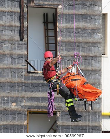 Fireman During An Exercise Carries The Stretcher