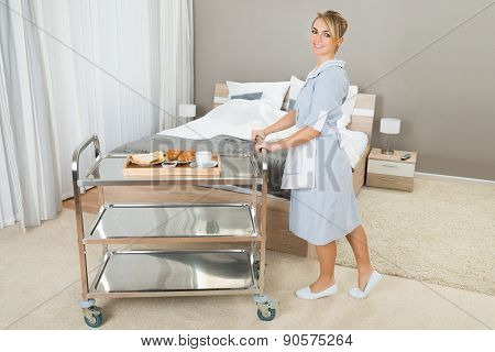 Woman Pushing Trolley With Breakfast