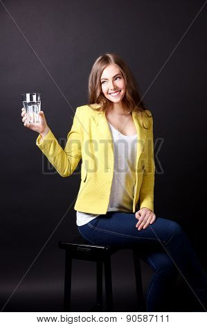 Happy Woman holding Glass Of Water