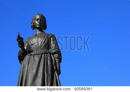 Victorian memorial statue of Florence Nightingale in Waterloo Place, Westminster, London, an English nurse known as 'the Lady With The lamp', who cared for wounded soldiers in the Crimean War poster