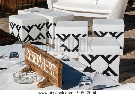 Reserved Wooden Furnished Table In Mountain Chalet