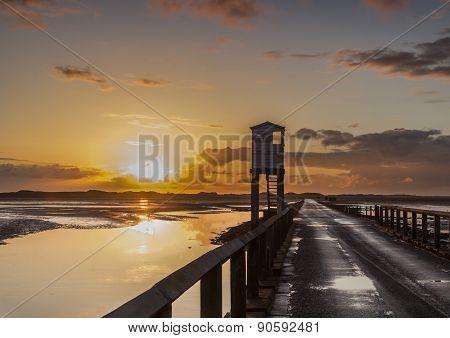 The Causeway to Holy Island at sunrise, Northumberland, England.