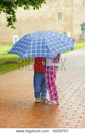 Kids Under The Umbrella
