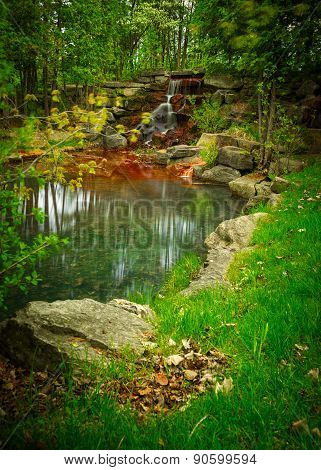Beautiful Small Waterfall Oasis In A Lush, Green Forest