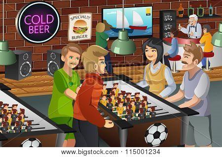People Playing Foosball