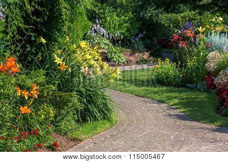 A stone walkway winding through a tranquil garden.