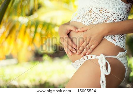Pregnant Belly Closeup. Heart And Motherly Love. Happy Pregnancy And New Life Concept.