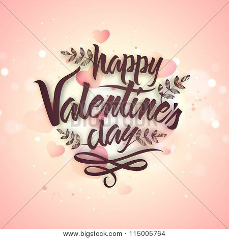 Elegant greeting card design decorated with stylish text Happy Valentine's Day on shiny pink background.