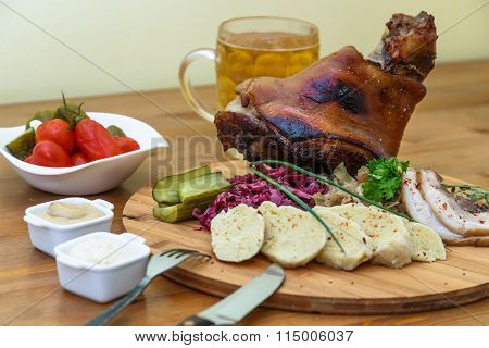 Traditional Czech Pork Knuckel On The Bone With Cabbage