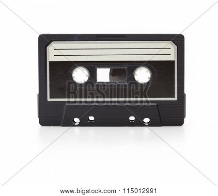 Early 70's cassette tape isolated on white with slight reflection. White blank label. (cassette is actually from the seventies, has dust and grime)