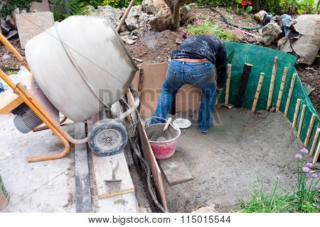 Man Coating With Cement An Artificial Pond