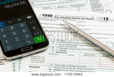 Pen And Smartphone On 2015 Form 1040
