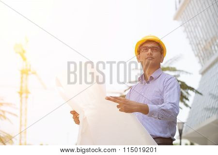 Indian Engineer On Construction Background