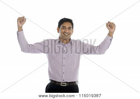 Excited Indian Businessman Jumping For Joy. Isolated On White Background.