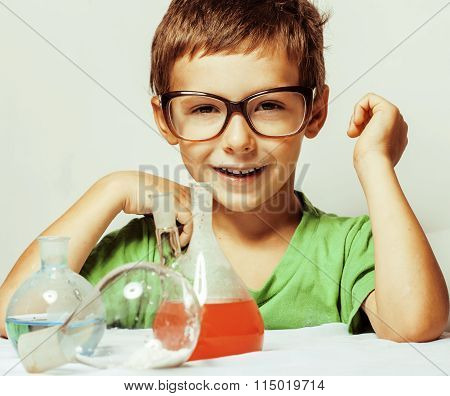 little cute boy with medicine glass isolated wearing glasses smiling close up genius kid