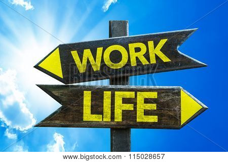 Work - Life signpost with sky background
