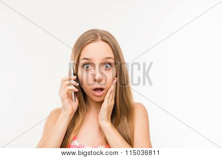 Surprised  Woman Talking On The Phone And Touching Her Face