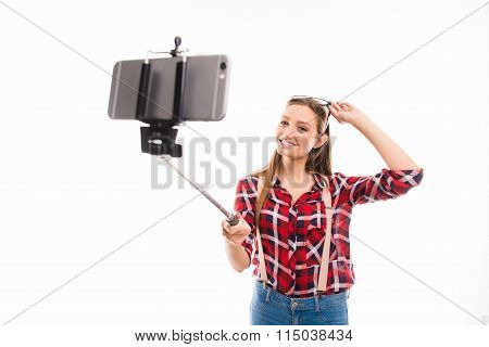 Long-haired Girl With Selfie Stick Taking Photo
