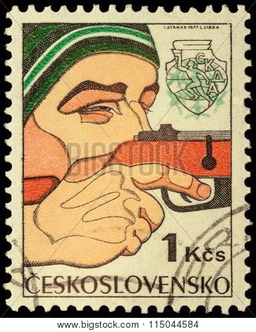 Man Shooting A Gun On Post Stamp