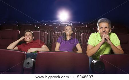 People sitting in movie theater, watching movie