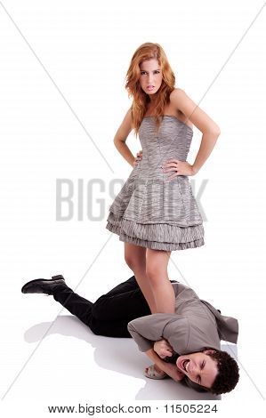 Handsome Young Man Crawling, Clinging To The Foot Of A Beautiful Woman, Isolated On White, Studio Sh