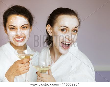 Young Happy Female Friends Drinking Champagne In Spa