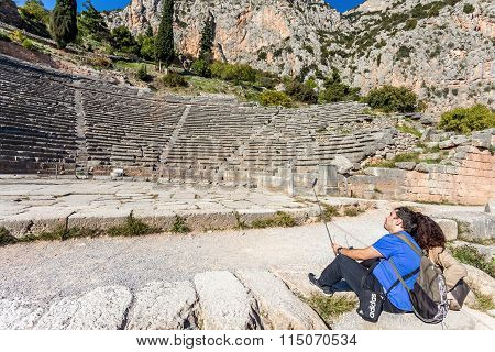 DELPHI, GREECE - NOVEMBER 11:couple making selfie on archaelogical site of Delphi, Greece