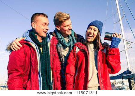 Three Young Friends Having Fun Before Embark On Boat At Pier - Cheerful People Smiling Outdoors
