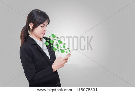 Businesswoman standing in the way hand phone to communicate Leaf out of the mobile media innovation