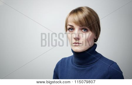 Beautiful Sad Girl With Big Blue Eyes Looking Into The Camera.