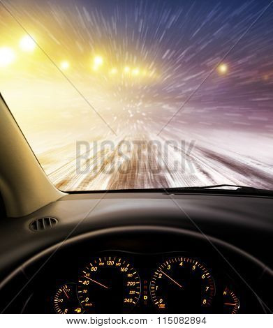 view through car windshield to snow-covered road