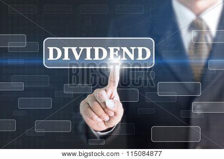 Businessman pressing DIVIDEND concept button.