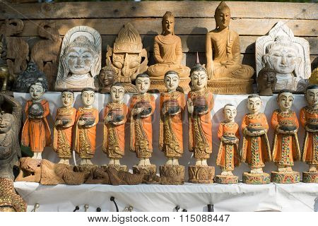 Colorful traditional puppets and image of Budha are sold as souvenirs
