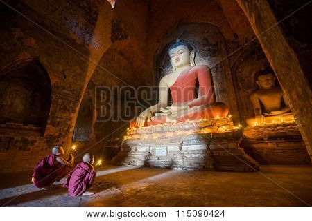 BAGAN, MYANMAR - DEC 13, 2015: Southeast Asian neophytes are in a Buddihist temple on December 13, 2015 in Bagan, Myanmar.