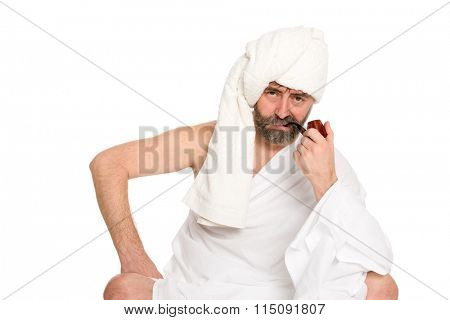 Serious man with a pipe in the sauna dress. From a series of Russian bath.