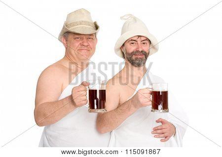 Joyful men in traditional bathing costumes drink kvas - russian bread juice. From a series of Russian bath