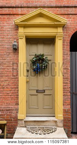Colonial Red Doorway In Historic Elfreth's Alley In Philadelphia With Pediment And  Christmas Wreath