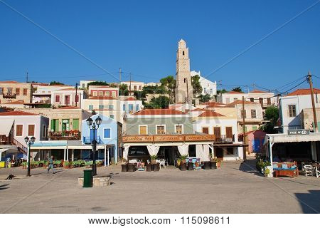 HALKI, GREECE - JUNE 17, 2015: The harbour front tavernas at Emborio on the Greek island of Halki. The small island near Rhodes has a permanent population of just under 300 people.