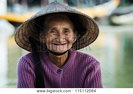 Old woman in Hoian ancient town, Vietnam.