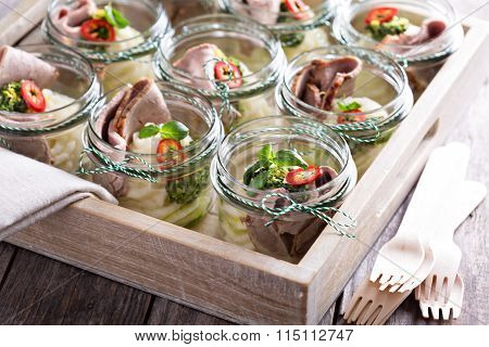 Roastbeef with mashed potatoes in small jars