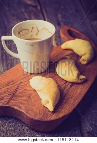 Vintage Photo Of Cup Of Coffee And Homemade Yeast Croissants