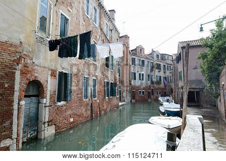 Clothes Hung To Dry Over Calm Canal In Venice, Italy