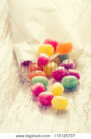 Vintage Photo Of Colorful Candies On Wooden Table