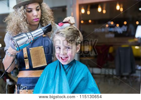Portrait Of Cheerful Boy In Barber Chair