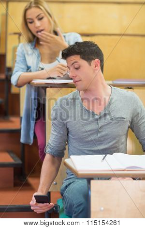 Cheating students during exam at the lecture hall